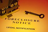 picture of eviction  - A key laying next to a house model and a foreclosure notice - JPG