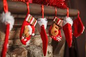Christmas Red Stocking Hanging From A Mantel Or Fireplace, Decorated For. poster
