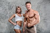 Beautiful Young Sporty Sexy Couple Men And A Woman Posing poster