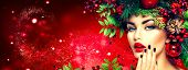 Christmas fashion model woman. Xmas New Year hairstyle and make up. Beauty Girl portrait. Gorgeous V poster