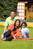 foto of happy family  - family having fun outdoors in front of their house - JPG