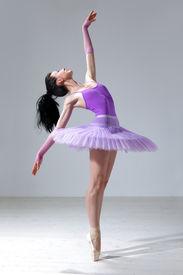 pic of ballet dancer  - modern style dancer posing on studio background - JPG