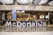 MADRID, SPAIN - AUGUST 7 : Customers having their meals at McDonald's Madrid airport in Madrid, Spai