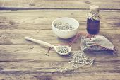Homemade Sachet With Wormwood, White Bowl With Dry Herb, Bottle Of Oil On Wooden Table, Monochrome S poster