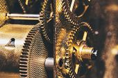 Closeup From Cogs Or Gears Into A Clockwork, Brass Background poster