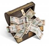 stock photo of dirhams  - An old wooden trunk filled with UAE Dirhams - JPG