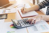 Close Up Hand Of Business Employee Accountant With Calculator Calculating Annual Income Tax And Comp poster