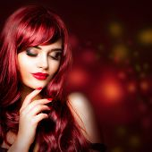 Perfect Redhead Woman Portrait. Glamorous Fashion Model With Makeup And Long Wavy Hair On Luxurious  poster