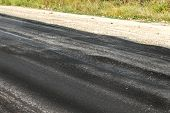 Damaged Road, Damaged Chopped Asphalt With Potholes And Spot. Very Bad Asphalt Road With Large Trenc poster