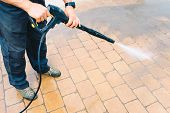 Outdoor Floor Cleaning With High Pressure Water Jet - Cleaning Concrete Block Floor On Terrace poster