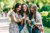 Summer Lifestyle Portrait Multiracial Women Enjoy Nice Day, Holding Glasses Of Milkshakes. Happy Fri poster