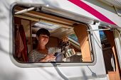 Woman cooking in camper, motorhome interior VR. Family vacation travel, holiday trip in motorhome, C poster