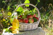 White Wicker Basket With Green And Red Apples, Apple Cider, Juice Or Vinegar In Glass Bottle, Leaves poster