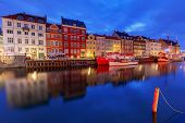 Multicolored Facades Of Old Medieval Houses And Ships Along The Canal Of Nyhavn. Denmark. poster
