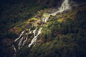 Scenic Glacial Waterfall. Pure Norwegian Landscape Scenery. poster