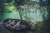Wooden Fishing Boat On The Scenic Lake Shore. Fisherman Theme. poster
