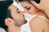 Close-up View Of Seductive Young Couple Able To Kiss In Foreplay poster