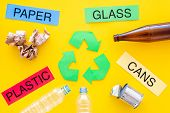Waste For Recycle And Reuse Near Recycle Symbol With Arrows. Words Paper, Glass, Plastic, Cans On Ye poster