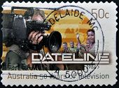 A stamp printed in Australia shows image celebrating 50 years of Dateline