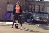 pic of kettlebell  - Ghetto girl with kettlebell in a crossfit training outdoor - JPG