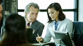 image of business meetings  - A group of business people discuss things at a meeting - JPG