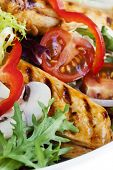 Grilled chicken salad, with lettuce, capsicum, mushrooms, tomatoes and red onion.