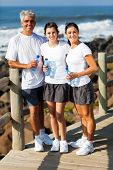 beautiful healthy family at the beach after exercise