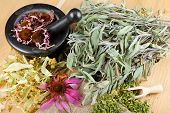 picture of hyssop  - healing herbs on wooden table mortar and pestle herbal medicine top view - JPG