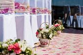 stock photo of gazebo  - flowers compositions in basket on wedding ceremony - JPG