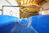 Large multi-colored water slides in indoor aquapark. Descent blue slide.
