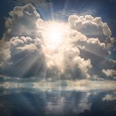 stock photo of heavenly  - The sun on dramatic sky over sea - JPG