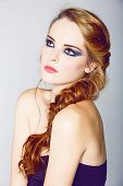 foto of gothic hair  - beautiful young woman with blond red hair in fishtail braid and dramatic eye makeup - JPG