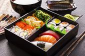 picture of soy sauce  - bento box with sushi and rolls - JPG