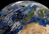 Irish flag on pole on earth globe illustration - Elements of this image furnished by NASA