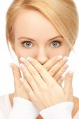 stock photo of hush  - picture of amazed woman with hand over mouth - JPG