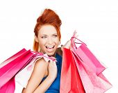 picture of funny woman with shopping bags .