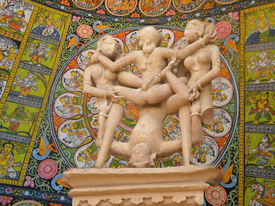 pic of kama  - Erotic sculptures from Khajuraho India depicting positions from the Kama Sutra set against colorful Indian backgrounds