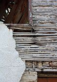 stock photo of derelict  - Old lath and plaster on exterior of old derelict house - JPG