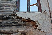pic of derelict  - Old lath and plaster on exterior of old derelict house - JPG