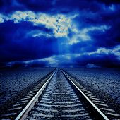 railroad in night to cloudy horizon