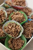 stock photo of crispy rice  - Rice crispy treats in cupcake trays prepared for a party - JPG