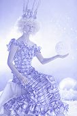 pic of boll  - girl in crown with christmas boll is on a smoke background - JPG