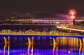 Seoul city night with firework