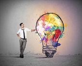 stock photo of pen  - Concept of Creative business idea with colorful lightbulb - JPG