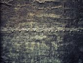 pic of stelles  - Closeup of grunge black metal plate with rivets and screws as background or texture - JPG