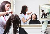 image of hair dye  - Professional female hairdresser applying color to female customer at design hair salon woman having her hair dyed Hair dye colouring in process - JPG