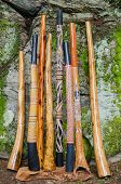stock photo of didgeridoo  - A Collection of Traditional and Handmade Didgeridoo - JPG