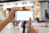 stock photo of sms  - Using smartphone in a market or department store - JPG