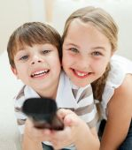 image of televisor  - Cute brother and sister watching TV in the living - JPG