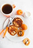 foto of loquat  - Cottage cheese pancakes and fresh loquat for breakfast